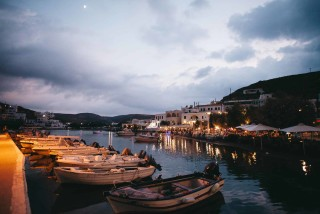 about kythnos porto klaras small fish boats by night overlooking local restaurants at the port