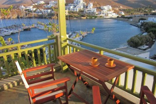 about loutra porto klaras studios with balcony view and outdoor table where you can enjoy greek coffee and admire the view of Kythnos island