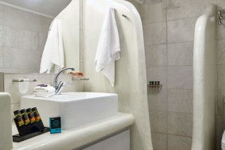 family suites porto klaras bathroom facilities include towels, bathroom products like soap, shower gel and soap made of olive