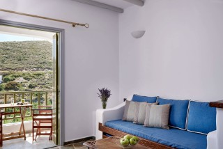 family suites porto klaras sitting area with elegant furniture and view of Kythnos Island
