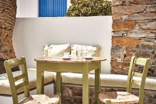 gallery porto klaras sitting table next to the garden where you can enjoy a cup of Greek coffee