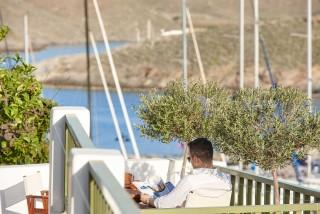gallery porto klaras man sitting at the sea view veranda