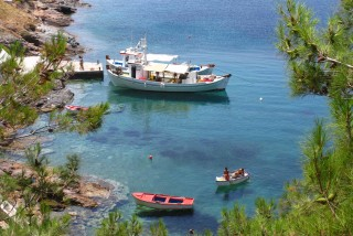 introduction porto klaras kythnos small boats in the greek sea of the cyclades