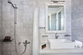 standard studios porto klaras bathroom with shower and bath products