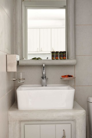 VIP studios porto klaras bathroom with elegant furniture and brand bath products: shampoo, shower gel and olive soap