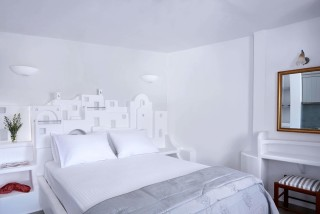 VIP studios porto klaras big double bed built according to Cycladic architecture