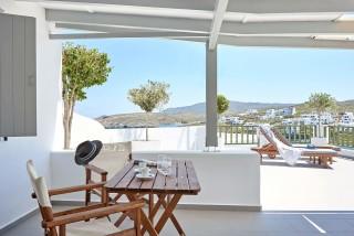 VIP studios porto klaras big veranda with romantic sea view and wooden furniture and sunbeds