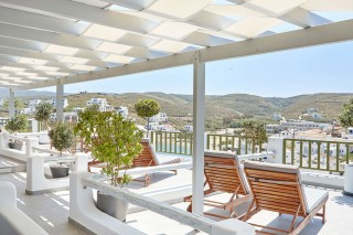 VIP studios porto klaras big sea view balcony with wooden sunbeds and romantic view of Kythnos and the Aegean Sea