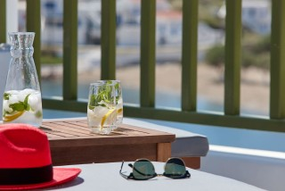 VIP studios porto klaras balcony with wooden sunbeds overlooking the Aegean Sea