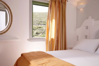 junior suite porto klaras bedroom with view of Kythnos Island