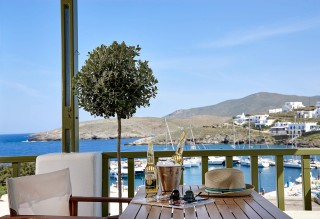 junior suite porto klaras balcony with Aegean Sea view and corona beer