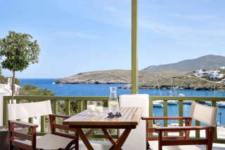 junior suite porto klaras veranda with sea view where you can taste a drink in Kythnos