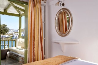 junior suites porto klaras Cycladic elegant bedroom with view of Loutra Beach and Kythnos Island