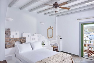 superior studio porto klaras double bedroom with balcony and view of kythnos island