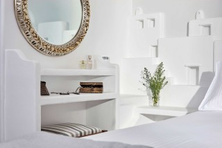 VIP studios porto klaras bedroom amenities, mirror, flowers and cosmetics