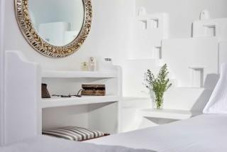VIP studios porto klaras bedroom amenities, mirror, flowers and cosmetics