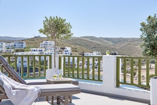VIP studios porto klaras big balcony with wooden sunbeds and romantic sea view of Kythnos and the Aegean Sea