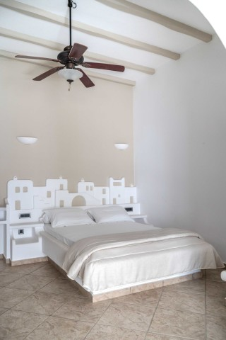 porto klaras junior suites cozy bedroom