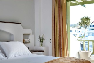 standard studios porto klaras cozy bedroom next to the balcony that offers sea view