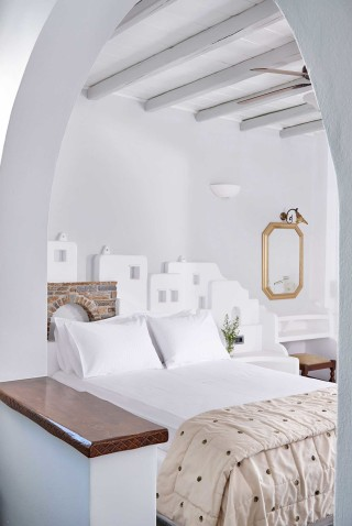 superior studios porto klaras sunny bedroom side with mirror and amazing decoration